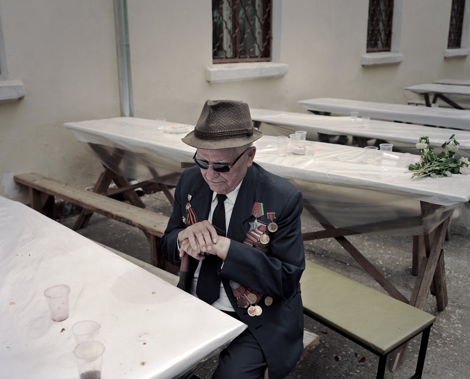 Blind veteran, left alone after the war, listening to
